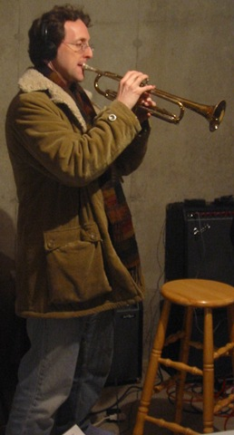 Mark Peter Hughes Today Mark plays trumpet with his band, The Church Ladies