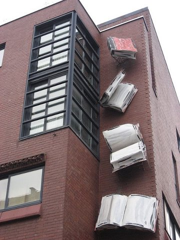 BITW Book Sculpture on the side of a building