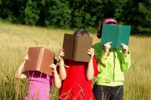 Three Little Readers, lost in their books.